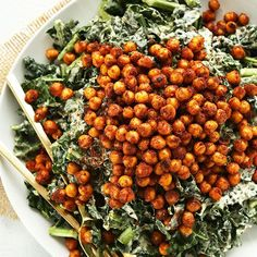 A simple, 30-minute kale salad with a creamy, roasted garlic dressing and tandoori-roasted chickpeas! A healthy, hearty entrée or side salad.