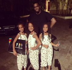 Diddy strikes a pose with his cute daughters