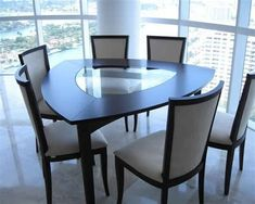 modern dining room triangle dining table with black finishing and additional glass center panel black framed dining chairs Dinning Table Design, Dining Table Chairs, Dinning Room Sets, Sweet Home Design, Esstisch Design, House Styles, Home Decor, Glass Center, Bamboo Furniture