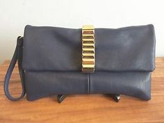 Navy Blue Clutch Bag With Gold Detail