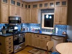 Image detail for -... kitchen. Tile counter tops and mosaic tile backsplash illuminated by