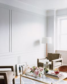 How to Add Architectural Detail With Paneling & Molding | Here's how to add a little architectural character to your small space. Molding on walls can give and elevated, elegant appearance to any room looking for a sleek, european touch. It draws the eye upward, making rooms seem bigger too!