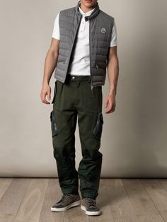 Light-grey quilted cotton gilet with a buttoned high neck collar, a front zip opening and zipped side pockets. The ultimate in luxury athletic style, this Moncler piece is perfect for slick comfort and style.    Shown here with Lanvin Lace-up trainers, Moncler R trousers and Valentino Shirt-back piqué polo top.
