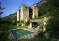 This unusual house was designed by Arturo Montanelli for himself and his family. The house is located on a sloping site, which has an excellent view of Lake Como – the most beautiful lake in Italy.