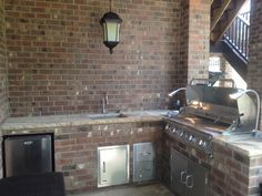 Outdoor kitchen includes: Brick and stone work, stainless appliances and under mount sink with hot and cold water. Really love the grill lights that we gave the client as their house warming gift...Pun intended!