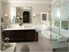 I want side sconce lighting in the bathrooms. I like this layout of two sconces, one large mirror over double sinks.