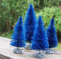 Bottle brush Christmas trees! Just cut to shape, spray paint, and secure into solid base.