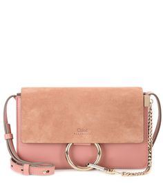 Chloé - Faye Small suede and leather shoulder bag - Chloé's 'Faye' bag is timeless and elegant. In light pink leather, it features an orange suede flap to the front and is accented with a silver- and gold-tone loop and chain detail. Go hands-free by wearing it cross-body, keeping all your essentials organised in the separate internal compartments. seen @ www.mytheresa.com
