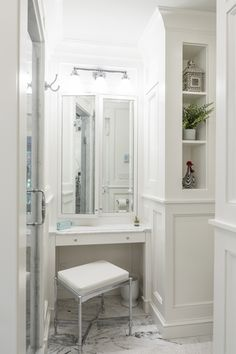A nook carved into this master bathroom redo serves as a sweet make-up counter.