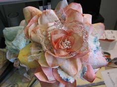 I thought I would show the rose first. Then you would have your curiosity engaged and stick around for the rest of the PAPER FLOWER TUTORIAL. I was inspired by Ulla's post with a link to Miz Smoochie Lips blog...