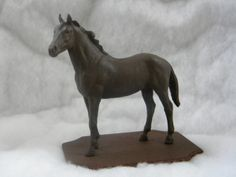 """""""The Mighty Thoroughbred"""" Just like an ex-racer, this Breyer model has been recycled and given a new purpose as a """"stone"""" statue on a wooden base! $20 plus shipping.  #ottb"""