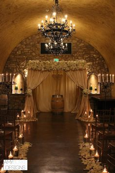 Such a beautiful wine cave wedding ceremony with candles, rose petals, and a chuppah. Roses and peonies are the perfect flowers for a wine country ceremony. Location Meritage Hotel and Spa Napa, CA #romantic