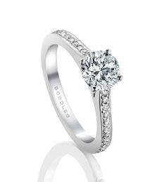 Boodles Grain-Set Solitaire Diamond Ring. Available from 0.50ct  and further 0.19ct of round-brilliant cut diamonds in a platinum shank