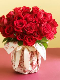 Seasonal Table Bouquet  Wrapped in fabric and tied with a ribbon, a vase or jar is stylishly dressed for the holidays. Fill the container with water and add a bouquet.