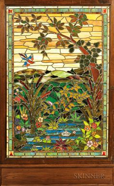 Framed Stained Glass Panel of a Watery Landscape, early 20th century, in the manner of Duffner and Kimberly, polychrome decoration depicting a tree and plants by the water with birds and flowers, glass panel ht. 61, wd. 41 1/2, original frame, ht. 67, wd. 47 1/4, and later surround, ht. 78 1/2, wd. 49 in.