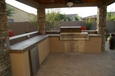 """would the concept here work for us  - eg """"half"""" verandah to the NW from house 2, work - basic a elements bbq with brazier, side burner, stainless sink, fridge, storage,  Outdoor Kitchen Pergola Outdoor Kitchen Alexon Design Group Gilbert, AZ"""