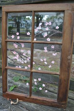 an original painting of cherry blossoms on a vintage 1940's window
