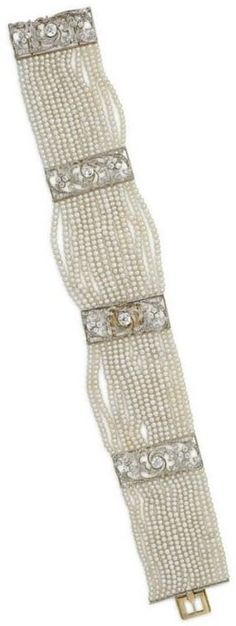 A BELLE EPOQUE SEED PEARL AND DIAMOND DOG COLLAR NECKLACE, BY TIFFANY & CO. Designed as fourteen-strands of seed pearls, with old-cut diamond openwork spacers and clasp of floral motif, circa 1895, mounted in platinum-topped gold, may also be worn as two bracelets. Signed Tiffany & Co., Paris. #Tiffany  #BelleÉpoque #choker