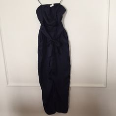 JUMPSUIT Beautiful navy blue silk. new with tags! Tags still attached! J.Crew Collection jumpsuit. Crossover front with small button. Elastic waist but has side zipper. Silk tie around waist. Two front packets and two faux back pockets J. Crew Pants Jumpsuits & Rompers