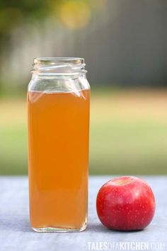Homemade organic raw apple cider vinegar - use leftover apple peels and cores to make apple cider vinegar.