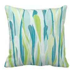 Freshen up your decor with this colorful pillow. Stylish with shades of spring grasses, light greens, teals and pale blue.