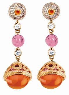 Pink, orange and rhinestone dangle earrings pinned by Maria