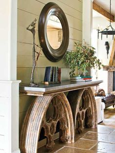 Rustic beams, WHITE walls (and beige accent wall), wrought iron chandelier and wall sconce, Don Quixote, heavy marble table, dark leather ... (leans toward Spanish more than Mexican)