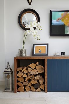Custom living room unit with log storage The Artful Woodpile: 30 Fabulous Firewood Storage Ideas!