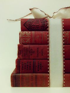 vintage books for weddings - awesome as a cake stand