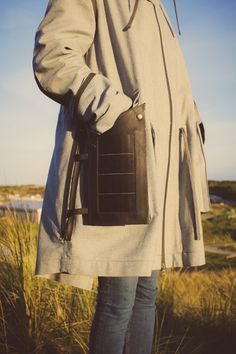 Fashion designer Pauline van Dongen has created a coat for workers on the Wadden Sea World Heritage site, with detachable solar panels on the pockets for charging electronic devices.