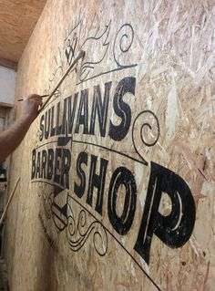 Sullivans Barber Shop Sign writing by Paul Banks. Design and signwriting of wall logo. On site for 3 hours despite the rough Sterling board surface. Barber Sign, Barbershop Design, Barbershop Ideas, Sign Writer, Wall Logo, Signwriting, Glow, Shop Front Design, Shop Plans