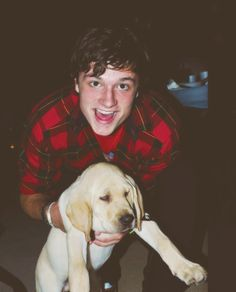 The fact that Josh Hutcherson is wearing plaid. Not to mention, he's also holding a puppy. Uum, YES.