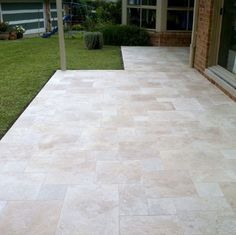 600mm x 400mm x 30mm Tumbled Travertine paving stone.  Travertine is close geological relation to limestone, is an enduring sedimentary rock that boasts an ironic history in both traditional and contemporary architecture.
