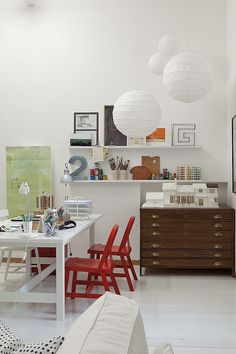 workspace. paper lantern chandelier. shelves. print drawers