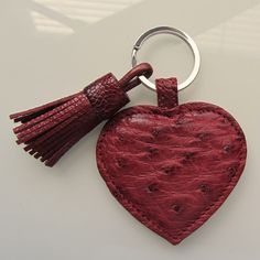 Leather keychain / keyfob made from genuine ostrich leather in bordeaux red and decorated with ostrich leather tassel charm by RinartsAtelier on Etsy