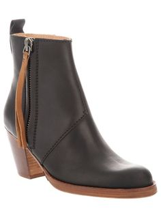 by Farfetch: Black Pistol Boot from Acne featuring a round toe, a leather sole, a tapered wooden heel a pull-on tab at the back and an inside zip fastening with a long tan leather zip pull.