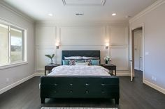 Wall paneling give this New Mexico bedroom lots of character!