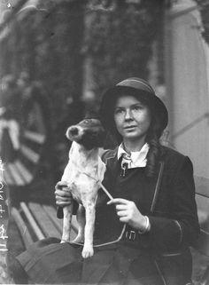 A schoolgirl with her Rat Terrier, 1930