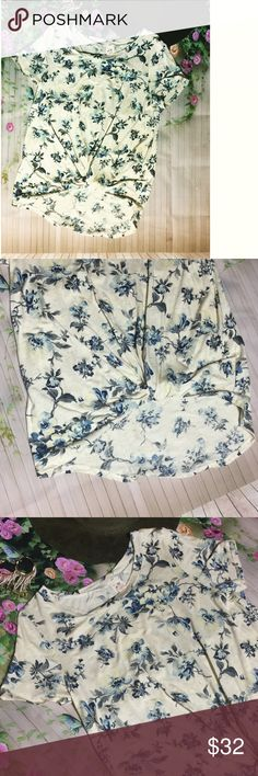 "Just in Floral tie knot tee NWT Just in Floral tie knot tee NWT. 98% polyester 4%spandex. Has a little stretch. Cute front tie. Dress up or casual, very versatile. S-armpit to armpit 16"", M 17"", L 18"". From shoulder to knot 19"" from shoulder to bottom in the back 26"". Cream, light blue, and navy blue. Tops Tees - Short Sleeve"
