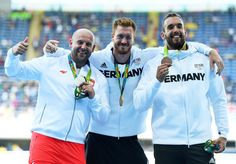 Silver medalist Piotr Malachowski of Poland, Gold medalist Christoph Harting of German and Bronze medalist Daniel Jasinski of Germany celebrate on the podium during the medal ceremony for the Men's Discus Throw Final on Day 8 of the Rio 2016 Olympic Games at the Olympic Stadium on August 13, 2016 in Rio de Janeiro, Brazil.