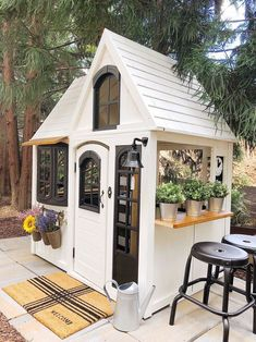 Our modern farmhouse makeover of Costcos Greystone Summit Playhouse into our girls very own outdoor marketplace! www. Modern Playhouse, Backyard Playhouse, Build A Playhouse, Painted Playhouse, Playhouse Ideas, Wooden Outdoor Playhouse, Playhouse Decor, Girls Playhouse, Costco Playhouse
