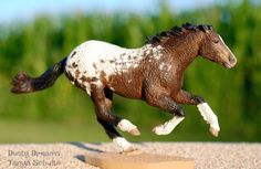 This amazing girl came all the way from France. She is a Custom Breyer Smarty Jones into a Bashkir Curly Mare, made specifically to go with the Heart's Fiesta Resin Foal by Kathleen Moody.