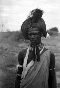 Africa |  Upper body portrait of a Shilluk man with elaborate coiffure and neck ornaments..  Southern Sudan, Upper Nile; possibly near Malakal. |  ca. 1939 || Wilfred Patrick Thesiger collection