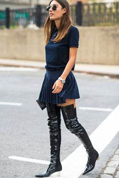 Preppy meets cool with pleats and thigh-high boots