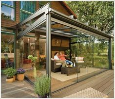Exterior : Interesting modern outdoor glass terrace beside house ideas by patio design with closed room made of glass with metal frame picture - a part of Amazing Summer Decoration Design Ideas for Outdoor Living Areas Pergola With Roof, Patio Roof, Pergola Patio, Pergola Kits, Pergola Ideas, Timber Pergola, Pergola Decorations, Gravel Patio, Spring Decorations