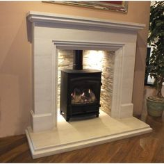 The new Calvi with its slate tile chamber is a fantastic and simple fireplace that is designed to go with any scenario, modern or traditional. Carved from solid limestone Calvi is taller than most fireplaces making it stand out. Simple Fireplace, Modern Fireplace, Fireplace Design, Fireplace Ideas, Fireplace Mantels, Wood Burner Fireplace, Limestone Fireplace, Fireplace Wall, Room Arrangement Ideas
