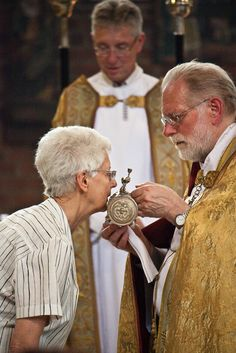 """Kissing the Relic of the Eucharistic Miracle of Boxmeer (Boxmeers) at Sint Petrusbasiliek-1400: Fr. Arnoldus Groen was celebrating Mass and immediately after he consecrated the Host and wine, the consecrated wine changed to Blood as though it was boiling, it began bubbling out of the chalice and onto the corporal. When the wine changed to Blood, it coagulated in a great lump. It is known as """"Boxmeerse Heilig Bloed"""""""