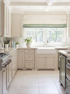 Tobi Fairley Interior Design. Roman Shade for Kitchen with different colored band at the bottom. White kitchen
