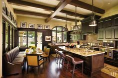 "Photo: Robert Reck""Other than some bikes in the garage, you wouldn't know who lives here,"" professional cyclist Lance Armstrong said of his Spanish Colonial–style house in Austin, Texas, which was decorated by his ""partner-in-design-crime since 1995,"" Roy W. Materanek. Framed family photographs perched atop the millwork create a striking frieze. The kitchen's glass door and large windows maximize views of the terrace and garden; the range and microwave are by Viking, and the sinks are by…"