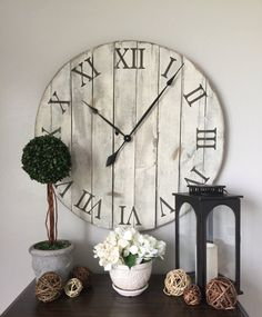 30 handmade wooden clock assembled from repurposed pallet boards. The color of paint used on the clock is hotel vanilla, and the Roman